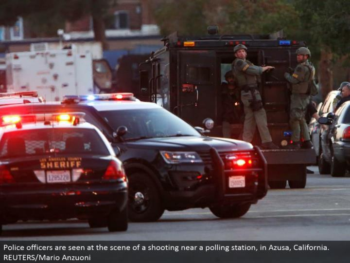 Police officers are seen at the scene of a shooting close to a surveying station, in Azusa, California. REUTERS/Mario Anzuoni