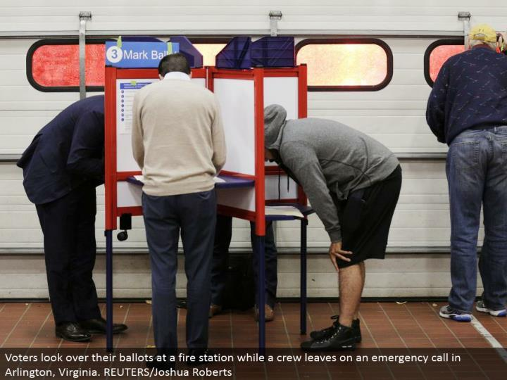 Voters investigate their tickets at a fire station while a group leaves on a crisis bring in Arlington, Virginia. REUTERS/Joshua Roberts