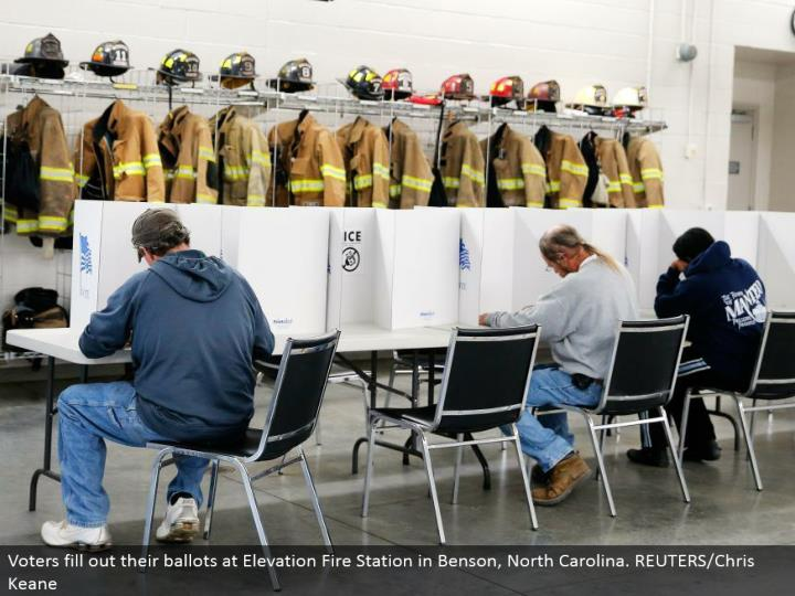 Voters round out their tickets at Elevation Fire Station in Benson, North Carolina. REUTERS/Chris Keane