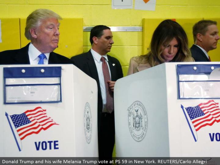 Donald Trump and his significant other Melania Trump vote at PS 59 in New York. REUTERS/Carlo Allegr...