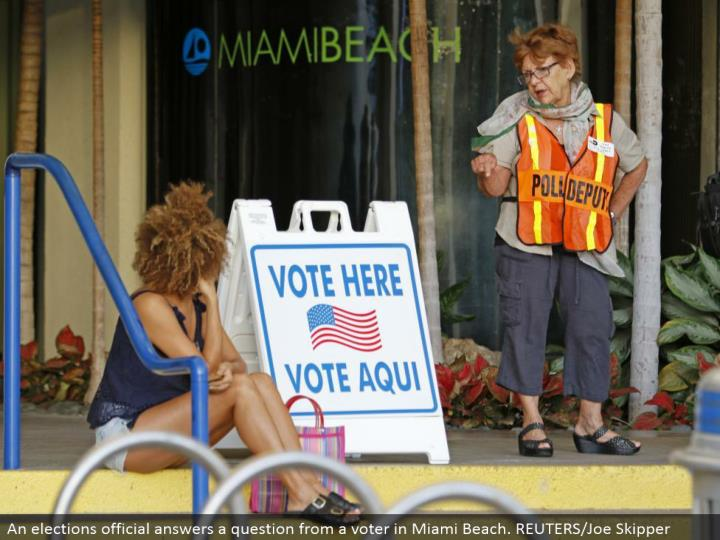An races official answers a question from a voter in Miami Beach. REUTERS/Joe Skipper