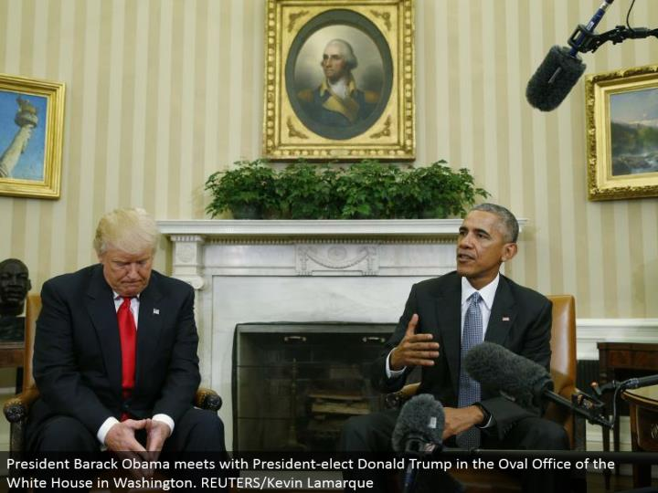 President Barack Obama meets with President-elect Donald Trump in the Oval Office of the White House in Washington. REUTERS/Kevin Lamarque