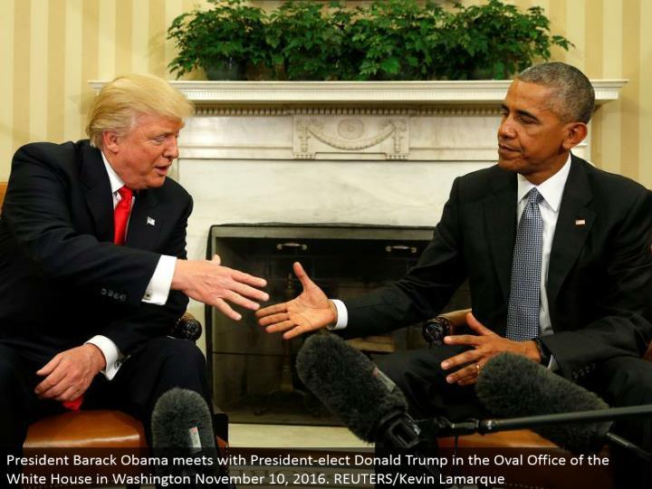 President Barack Obama meets with President-elect Donald Trump in the Oval Office of the White House...