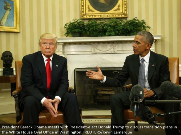 President Barack Obama meets with President-elect Donald Trump to talk about move arranges in the White House Oval Office in Washington. REUTERS/Kevin Lamarque