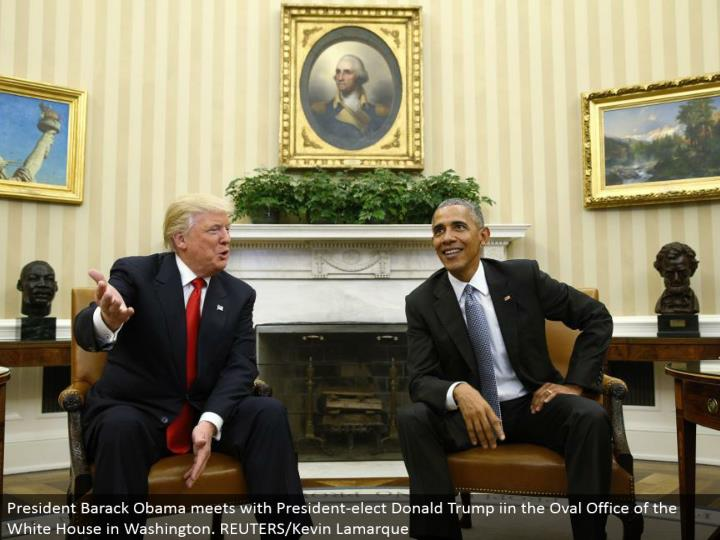 President Barack Obama meets with President-elect Donald Trump iin the Oval Office of the White House in Washington. REUTERS/Kevin Lamarque