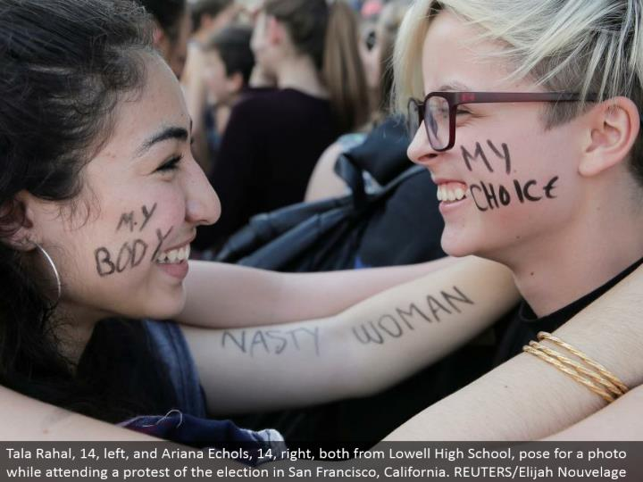 Tala Rahal, 14, left, and Ariana Echols, 14, right, both from Lowell High School, posture for a phot...