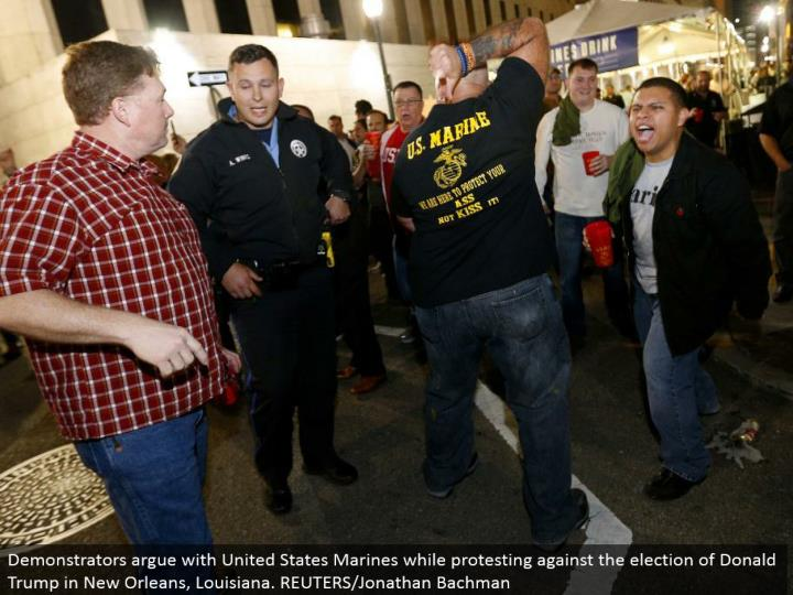 Demonstrators contend with United States Marines while challenging the decision of Donald Trump in New Orleans, Louisiana. REUTERS/Jonathan Bachman