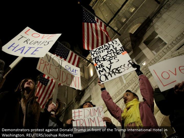 Demonstrators challenge Donald Trump before the Trump International Hotel in Washington. REUTERS/Joshua Roberts