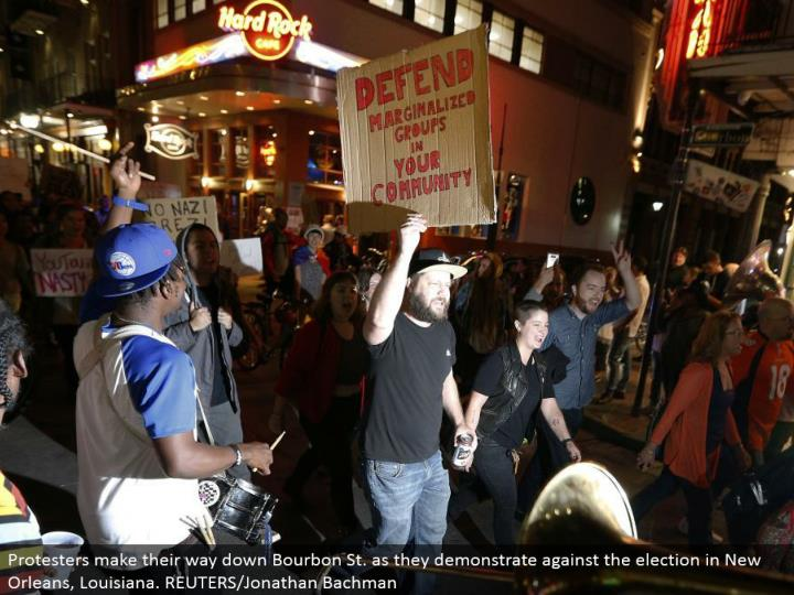 Protesters advance down Bourbon St. as they show against the race in New Orleans, Louisiana. REUTERS/Jonathan Bachman
