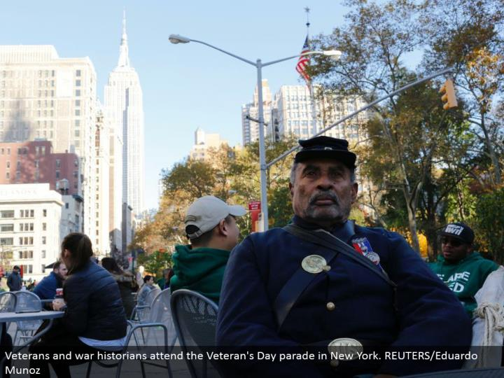 Veterans and war students of history go to the Veteran's Day parade in New York. REUTERS/Eduardo Munoz