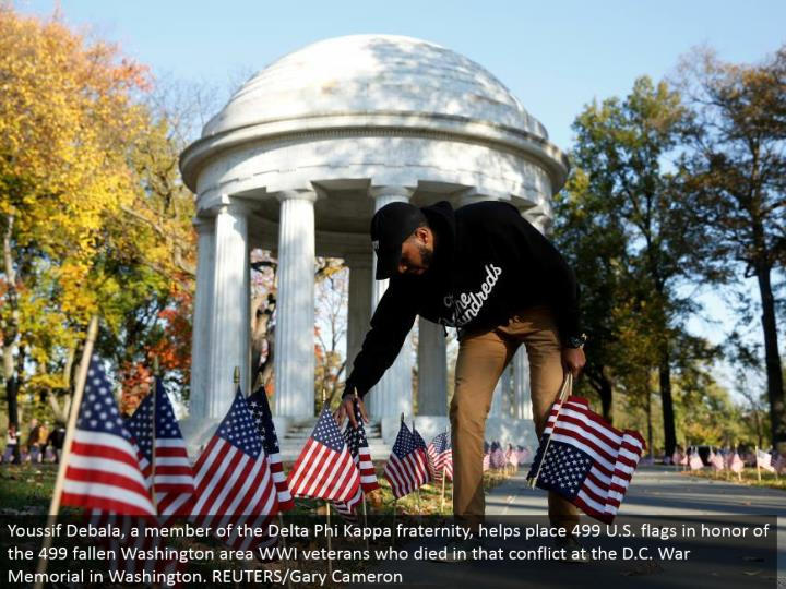 Youssif Debala, an individual from the Delta Phi Kappa club, places 499 U.S. signals to pay tribute to the 499 fallen Washington range WWI veterans who passed on in that contention at the D.C. War Memorial in Washington. REUTERS/Gary Cameron