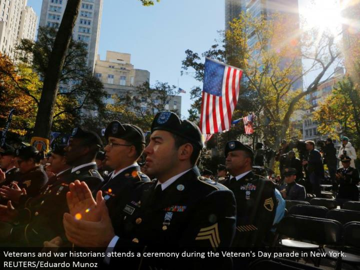 Veterans and war students of history goes to a function amid the Veteran's Day parade in New York. REUTERS/Eduardo Munoz