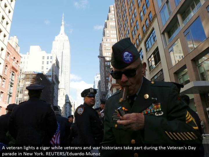 A veteran lights a stogie while veterans and war students of history participate amid the Veteran's Day parade in New York. REUTERS/Eduardo Munoz