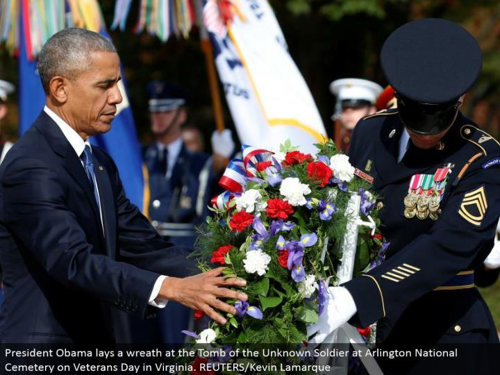 President Obama lays a wreath at the Tomb of the Unknown Soldier at Arlington National Cemetery on Veterans Day in Virginia. REUTERS/Kevin Lamarque