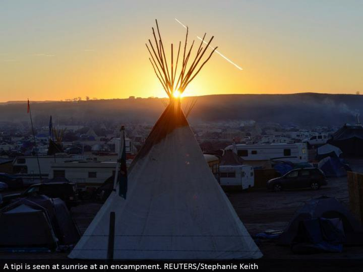 A tipi is seen at dawn at a settlement. REUTERS/Stephanie Keith