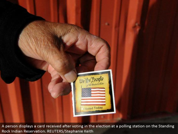 A individual shows a card got in the wake of voting in the decision at a surveying station on the Standing Rock Indian Reservation. REUTERS/Stephanie Keith