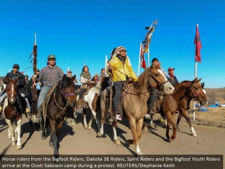 Horse riders from the Bigfoot Riders, Dakota 38 Riders, Spirit Riders and the Bigfoot Youth Riders touch base at the Oceti Sakowin camp amid a challenge. REUTERS/Stephanie Keith