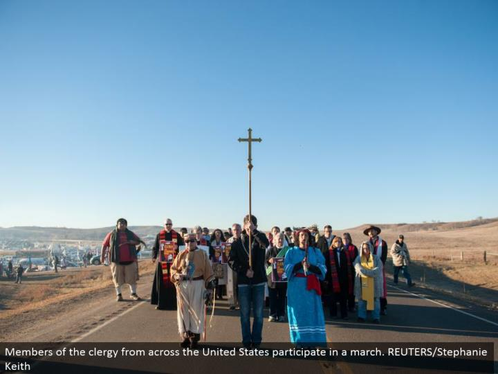 Members of the church from over the United States take an interest in a walk. REUTERS/Stephanie Keith