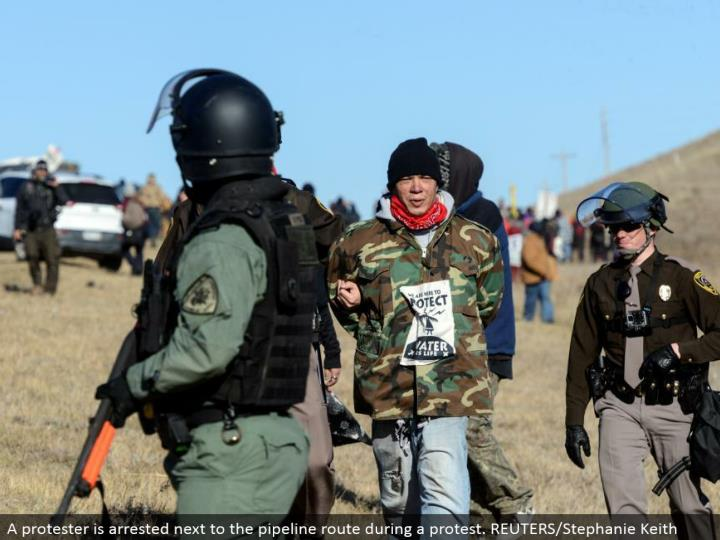 A dissident is captured alongside the pipeline course amid a challenge. REUTERS/Stephanie Keith