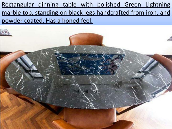 Rectangular dinning table with polished Green Lightning marble top, standing on black legs handcrafted from iron, and powder coated. Has a honed feel.