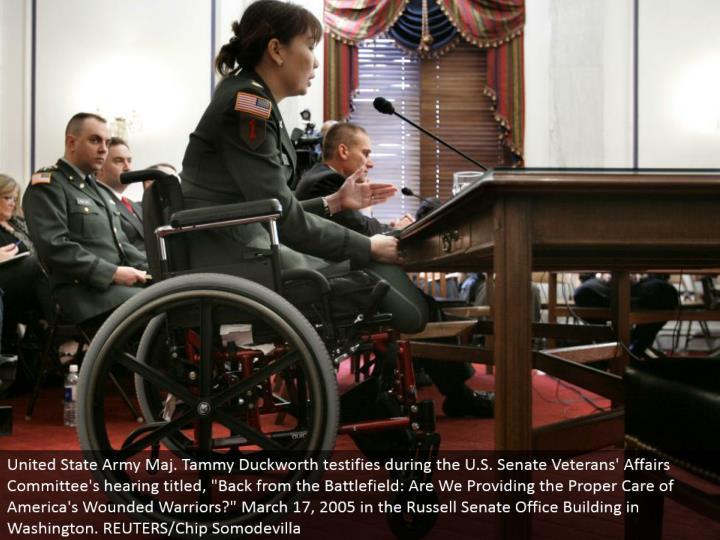 """United State Army Maj. Tammy Duckworth affirms amid the U.S. Senate Veterans' Affairs Committee's listening to titled, """"Once more from the Battlefield: Are We Providing the Proper Care of America's Wounded Warriors?"""" March 17, 2005 in the Russell Senate Office Building in Washington. REUTERS/Chip Somodevilla"""