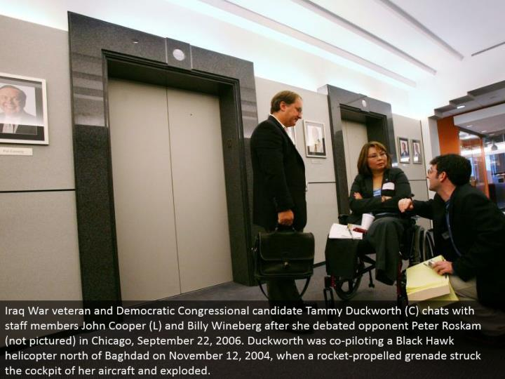 Iraq War veteran and Democratic Congressional hopeful Tammy Duckworth (C) visits with staff individuals John Cooper (L) and Billy Wineberg after she faced off regarding adversary Peter Roskam (not envisioned) in Chicago, September 22, 2006. Duckworth was co-guiding a Black Hawk helicopter north of Baghdad on November 12, 2004, when a rocket-moved projectile struck the cockpit of her flying machine and exploded.