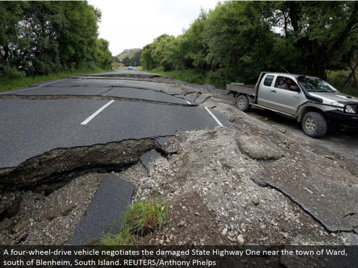 A four-wheel-drive vehicle arranges the harmed State Highway One close to the town of Ward, south of Blenheim, South Island. REUTERS/Anthony Phelps