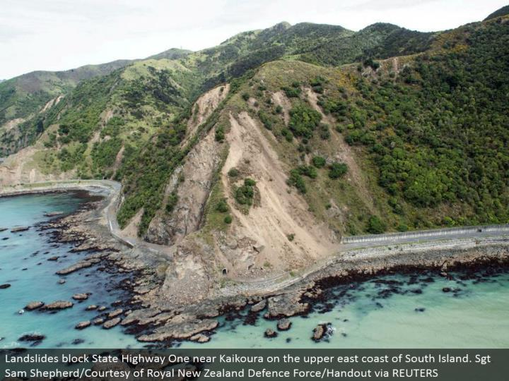 Landslides square State Highway One close Kaikoura on the upper east shoreline of South Island. Sgt ...