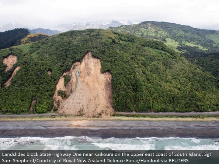 Landslides piece State Highway One close Kaikoura on the upper east bank of South Island. Sgt Sam Shepherd/Courtesy of Royal New Zealand Defense Force/Handout through REUTERS