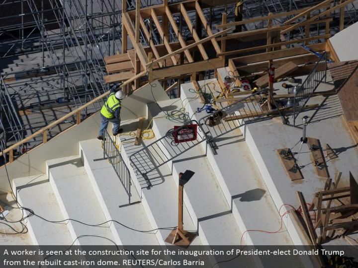A laborer is seen at the development site for the introduction of President-elect Donald Trump from the reconstructed cast-press arch. REUTERS/Carlos Barria
