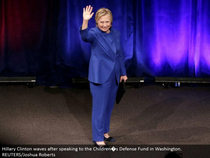 Hillary Clinton waves in the wake of addressing the Children�s Defense Fund in Washington. REUTERS/Joshua Roberts