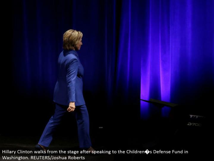 Hillary Clinton strolls from the phase subsequent to addressing the Children�s Defense Fund in Washington. REUTERS/Joshua Roberts