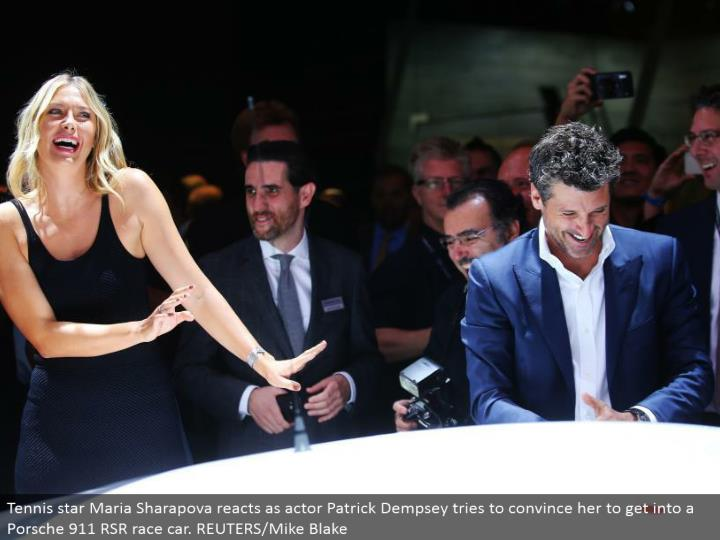 Tennis star Maria Sharapova responds as performing artist Patrick Dempsey tries to persuade her to get into a Porsche 911 RSR race auto. REUTERS/Mike Blake