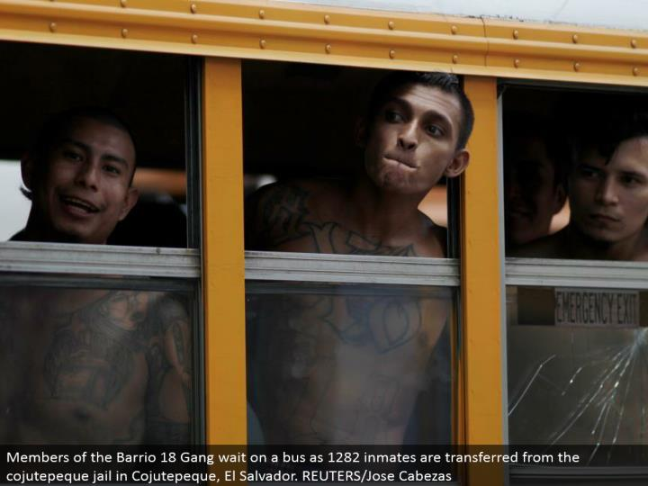 Members of the Barrio 18 Gang tend to a transport as 1282 detainees are exchanged from the cojutepeq...