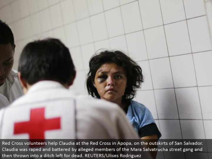 Red Cross volunteers help Claudia at the Red Cross in Apopa, on the edges of San Salvador. Claudia was assaulted and battered by claimed individuals from the Mara Salvatrucha road posse and afterward tossed into a jettison left for dead. REUTERS/Ulises Rodriguez