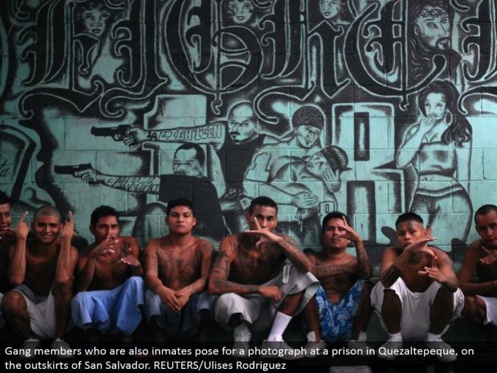Gang individuals who are likewise detainees posture for a photo at a jail in Quezaltepeque, on the edges of San Salvador. REUTERS/Ulises Rodriguez