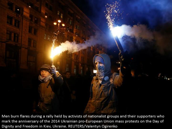 Men smolder flares amid a rally held by activists of patriot gatherings and their supporters who che...