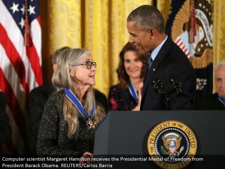 Computer researcher Margaret Hamilton gets the Presidential Medal of Freedom from President Barack Obama. REUTERS/Carlos Barria