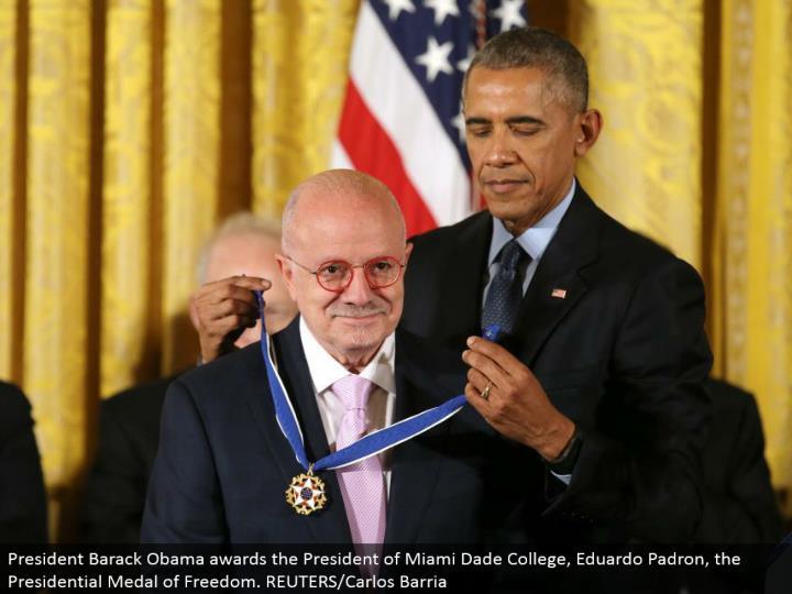 President Barack Obama grants the President of Miami Dade College, Eduardo Padron, the Presidential Medal of Freedom. REUTERS/Carlos Barria
