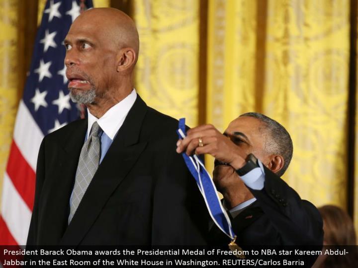 President Barack Obama grants the Presidential Medal of Freedom to NBA star Kareem Abdul-Jabbar in t...