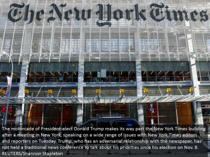 The motorcade of President-elect Donald Trump advances past the New York Times working after a meeti...
