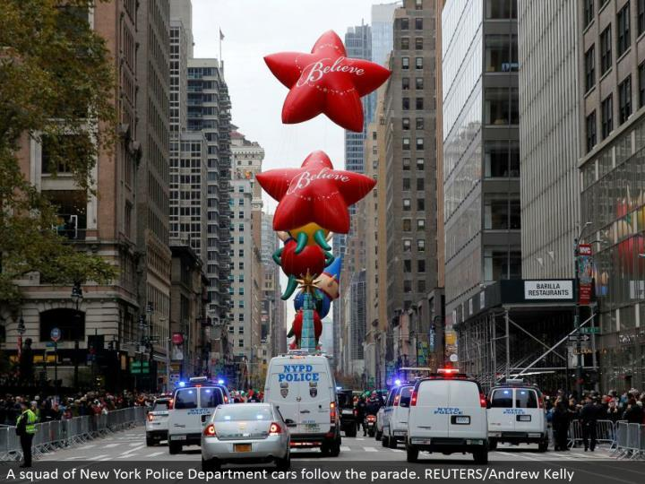A squad of New York Police Department autos take after the parade. REUTERS/Andrew Kelly