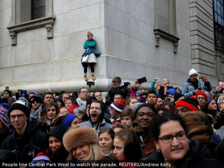 People line Central Park West to watch the parade. REUTERS/Andrew Kelly