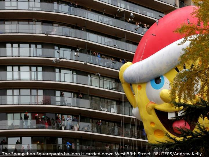 The Spongebob Squarepants inflatable is conveyed down West 59th Street. REUTERS/Andrew Kelly