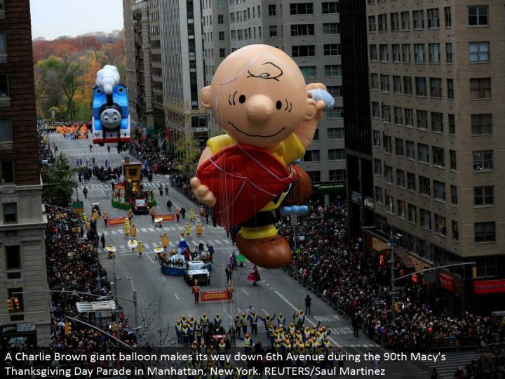 A Charlie Brown goliath expand advances down sixth Avenue amid the 90th Macy's Thanksgiving Day Parade in Manhattan, New York. REUTERS/Saul Martinez