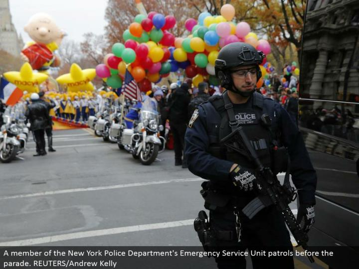 A individual from the New York Police Department's Emergency Service Unit watches before the parade. REUTERS/Andrew Kelly