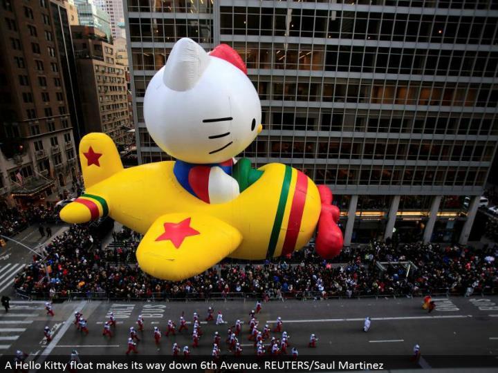 A Hello Kitty skim advances down sixth Avenue. REUTERS/Saul Martinez
