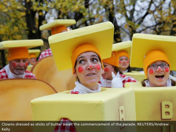 Clowns dressed as sticks of spread anticipate the beginning of the parade. REUTERS/Andrew Kelly