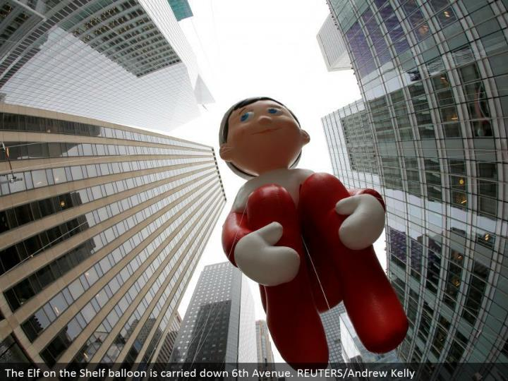 The Elf on the Shelf inflatable is conveyed down sixth Avenue. REUTERS/Andrew Kelly