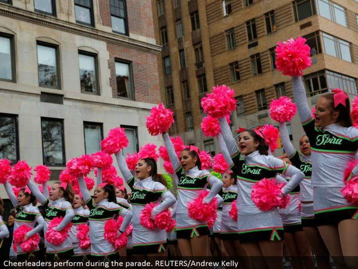 Cheerleaders perform amid the parade. REUTERS/Andrew Kelly